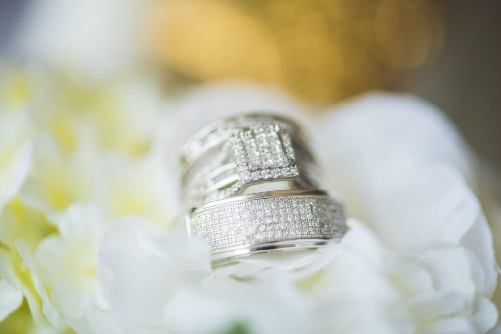 Silver diamond wedding rings close up