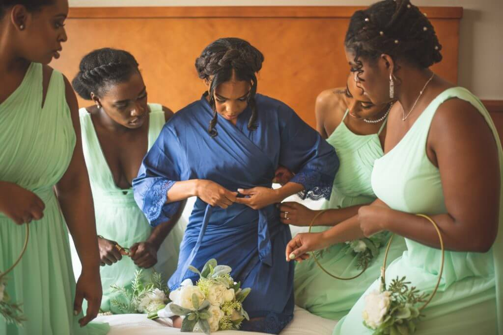 Bridesmaids getting read for wedding at hotel