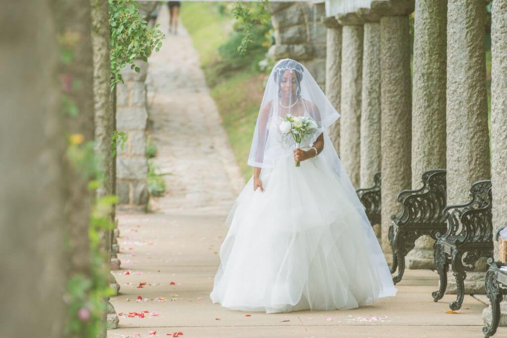Bride walking down the aisle in garden location