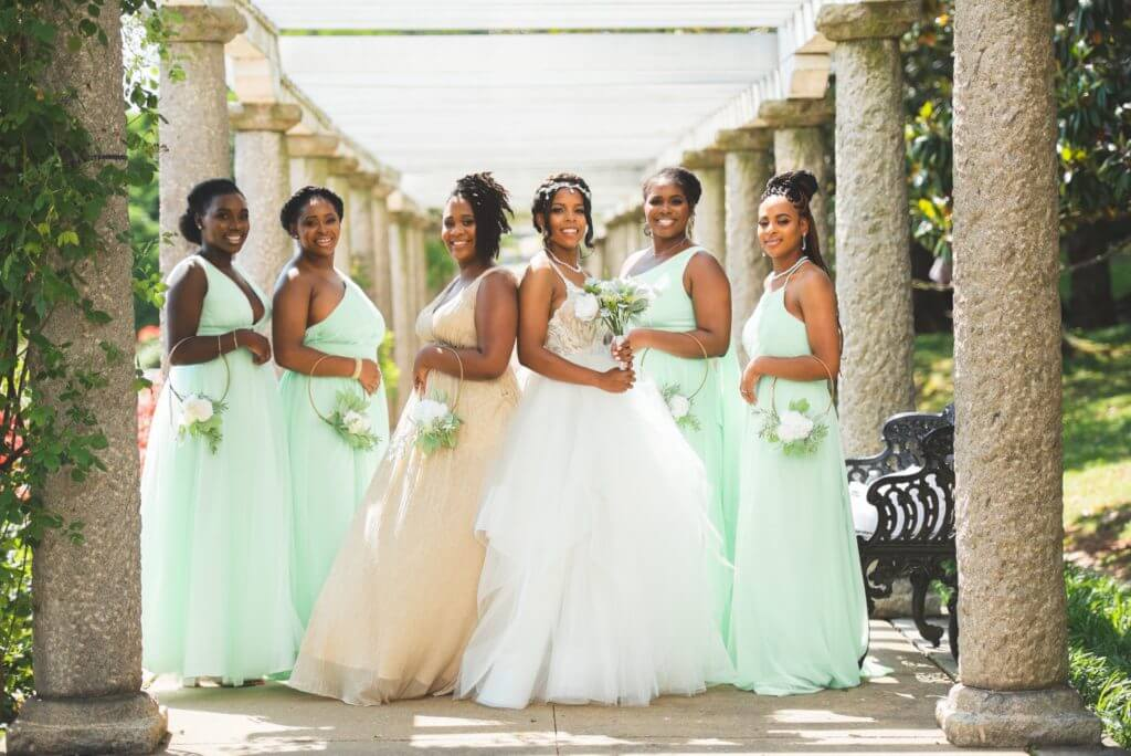Bride and Bridesmaids wearing mint green and tan