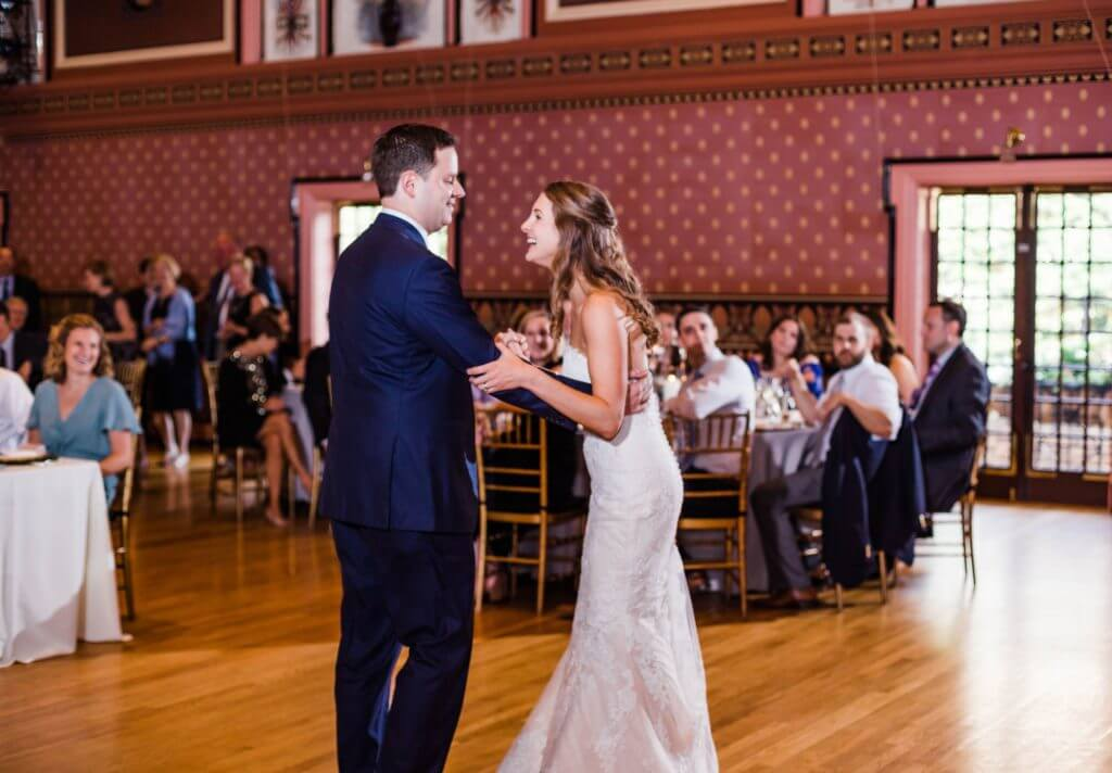 Bride and groom laugh together on the dance floor at Richmond, VA wedding.