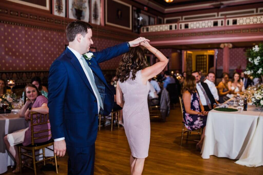Groom dances with his mom on his wedding day at The Bolling Haxall House.