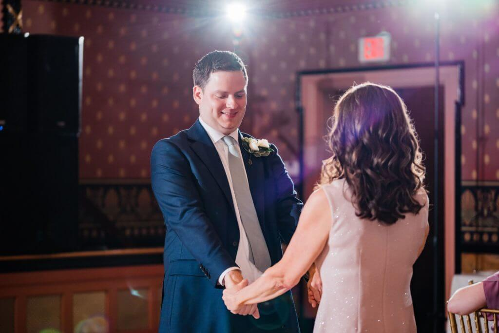 Groom dances with his mom on his wedding day.