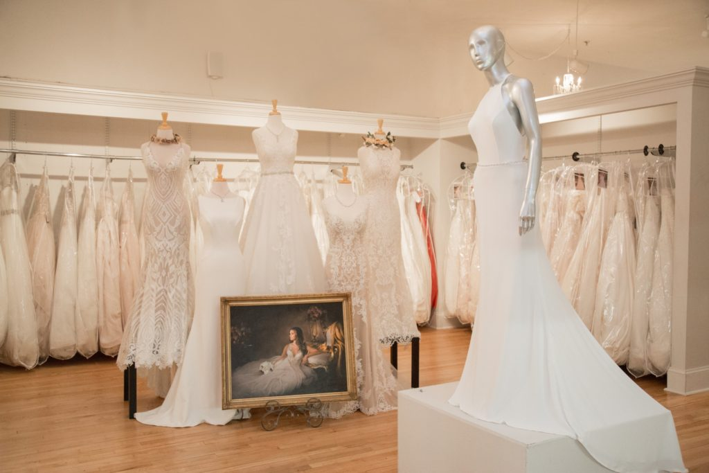 Bridal shop with dress options on a hanger behind